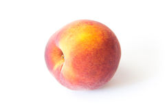 Ripe juicy peach isolated on white Stock Images