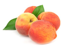 Ripe, juicy peaches. On a white background Royalty Free Stock Image
