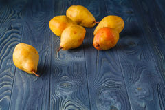 Ripe juicy pears conference on a dark wooden table Royalty Free Stock Image