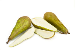 Ripe juicy pears with cuts on white. Background Royalty Free Stock Images