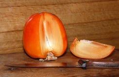 Ripe juicy persimmon Stock Image