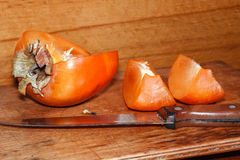 Ripe juicy persimmon Royalty Free Stock Images