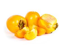 Ripe juicy persimmons with cuts on white Stock Image