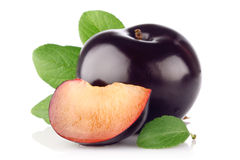 Ripe juicy plum with green leaf Royalty Free Stock Photo