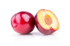 Ripe juicy plums on a white background Royalty Free Stock Photos