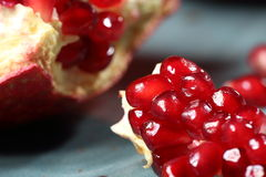 Ripe and juicy pomegranate broken into pieces, closeup Stock Photos