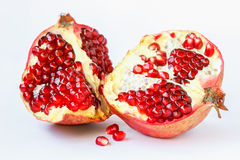 Ripe juicy pomegranate fruit isolated on white background. Close-up Stock Photo