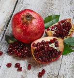 Ripe juicy pomegranate on wooden table Royalty Free Stock Photo