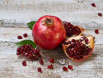 Ripe juicy pomegranate on wooden table Stock Photography