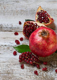 Ripe juicy pomegranate on wooden table Royalty Free Stock Photos