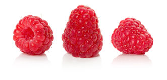 Ripe juicy raspberries on the white background Royalty Free Stock Photo