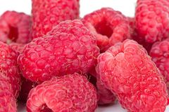 Ripe juicy raspberries on white table. On a white background Stock Photo