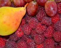 Ripe juicy raspberry and aromatic pear royalty free stock photos