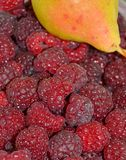 Ripe juicy raspberry and aromatic pear royalty free stock photo