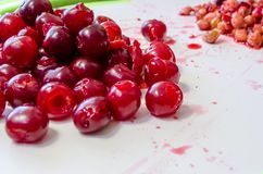 Ripe juicy red cherries pitted. Ripe juicy red cherries from which took bone royalty free stock photos