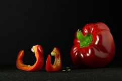 Ripe and juicy red pepper. With seeds on a dark background Royalty Free Stock Photography