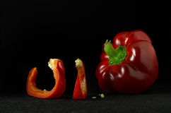Ripe and juicy red pepper. With seeds on a dark background Royalty Free Stock Image