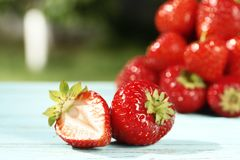 Ripe juicy strawberries close-up on a wooden background stock photography