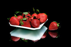 Ripe juicy strawberries closeup on a black background Royalty Free Stock Photography