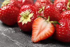 Ripe juicy strawberries on a dark background close-up royalty free stock image