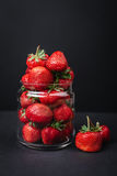 Ripe juicy strawberries in a glass on a dark background. Ripe juicy strawberries in a glass Stock Photo