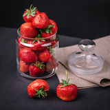 Ripe juicy strawberries in a glass on a dark background. Ripe juicy strawberries in a glass Stock Photography