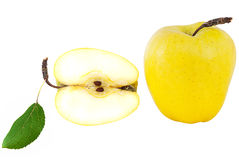 Ripe, juicy, sweet, yellow apple with a green leaf. Isolated on a white background Stock Photo