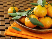 Ripe juicy tangerine, orange mandarin. With leaves on  wooden table Royalty Free Stock Photography