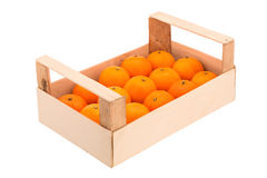 Ripe, juicy tangerines in a wooden box stacked in a one row Royalty Free Stock Photos