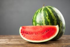 Ripe juicy watermelons. On a wooden table Stock Photos