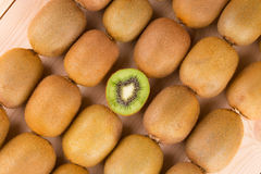 Ripe kiwi as a tile. Stock Photo
