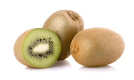Ripe kiwi in close up. On white background with shadows royalty free stock image