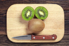 Ripe kiwi fruit and half Royalty Free Stock Image