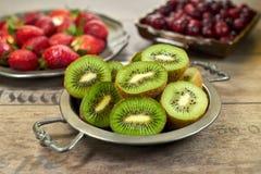 Ripe kiwi fruit on a metal plate stock photos