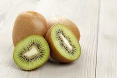 Ripe kiwi fruit on wood table, rustic photo Royalty Free Stock Photo