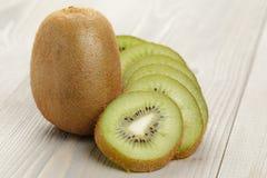 Ripe kiwi fruit on wood table, rustic photo Stock Image
