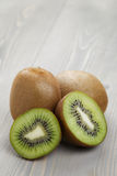 Ripe kiwi fruit on wood table Stock Photos