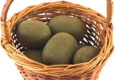 Ripe kiwi fruits in brown wicker basket isolated Royalty Free Stock Photos