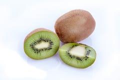 Ripe kiwi fruits with half Stock Images