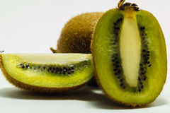 Ripe kiwi fruits with half Royalty Free Stock Images