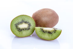 Ripe kiwi fruits with half  on white background Royalty Free Stock Photo
