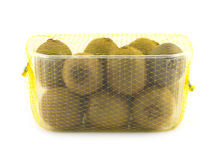 Ripe kiwi fruits in plastic container isolated closeup Royalty Free Stock Photos