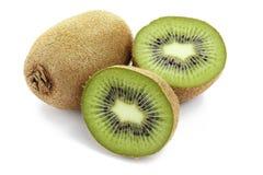 Ripe kiwi isolated. Ripe whole and sliced kiwi isolated on white background royalty free stock image