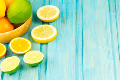 Ripe kiwi, lime, lemon, orange fruit on wooden vintage background. Healthy vegetarian food. Stock Photo