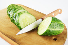 Ripe large cucumber on the cutting board Royalty Free Stock Photo