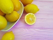 Ripe lemon group on a pink wooden background freshness place for text Royalty Free Stock Photo