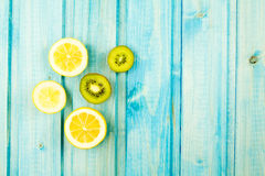 Ripe lemon, kiwi fruit on wooden vintage background. Stock Image