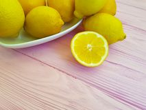 Ripe lemon on a pink wooden background freshness place for text Royalty Free Stock Photo