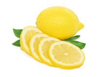 Ripe lemon and slices with green leaves on white background Stock Image