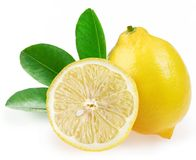 Ripe lemon with slices and leaves Stock Photography